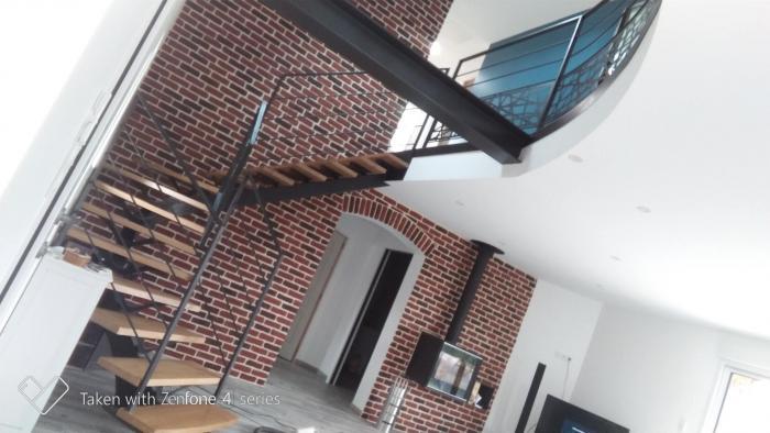 rénovation création d'un salon / pièce à vivre dans une longère en mayenne par Architéa 53 Mayenne